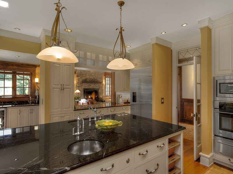 Traditional Kitchen with Laminate floors, Signature Hardware Bellevue Bridge Kitchen Faucet, Pendant light, L-shaped