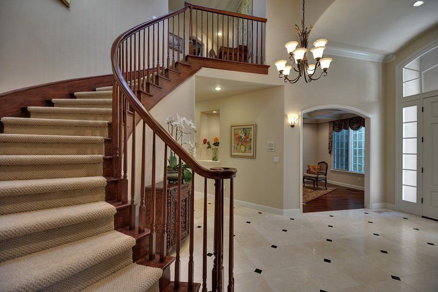 Traditional Staircase with curved staircase, Carpet, Standard height, Hardwood floors, interior wallpaper