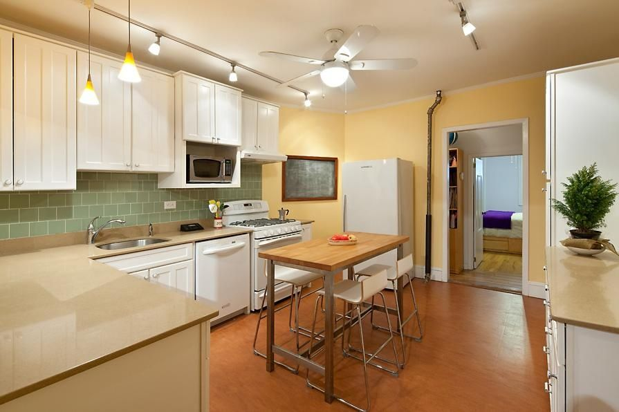 Modern Kitchen with gas range, Track lighting, Subway Tile, Undermount sink, Bamboo floors, Wire base bar stool, Ceiling fan