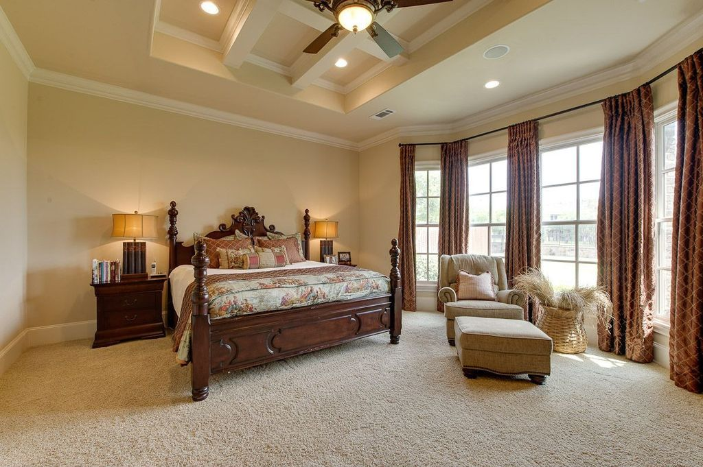 Traditional Guest Bedroom with can lights, Casement, Ceiling fan, High ceiling, picture window, flush light, Carpet