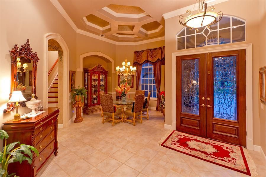 Traditional Entryway with Glass panel doors, Paint 2, stone tile floors, Crown molding, Traditional candle chandelier, Paint