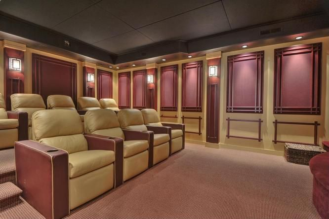 Home Theater with Crown molding, Carpet, Wall sconce