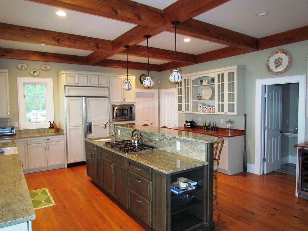 Traditional Kitchen with U-shaped, Pendant light, Standard height, Breakfast bar, Flat panel cabinets, Kitchen island, Flush