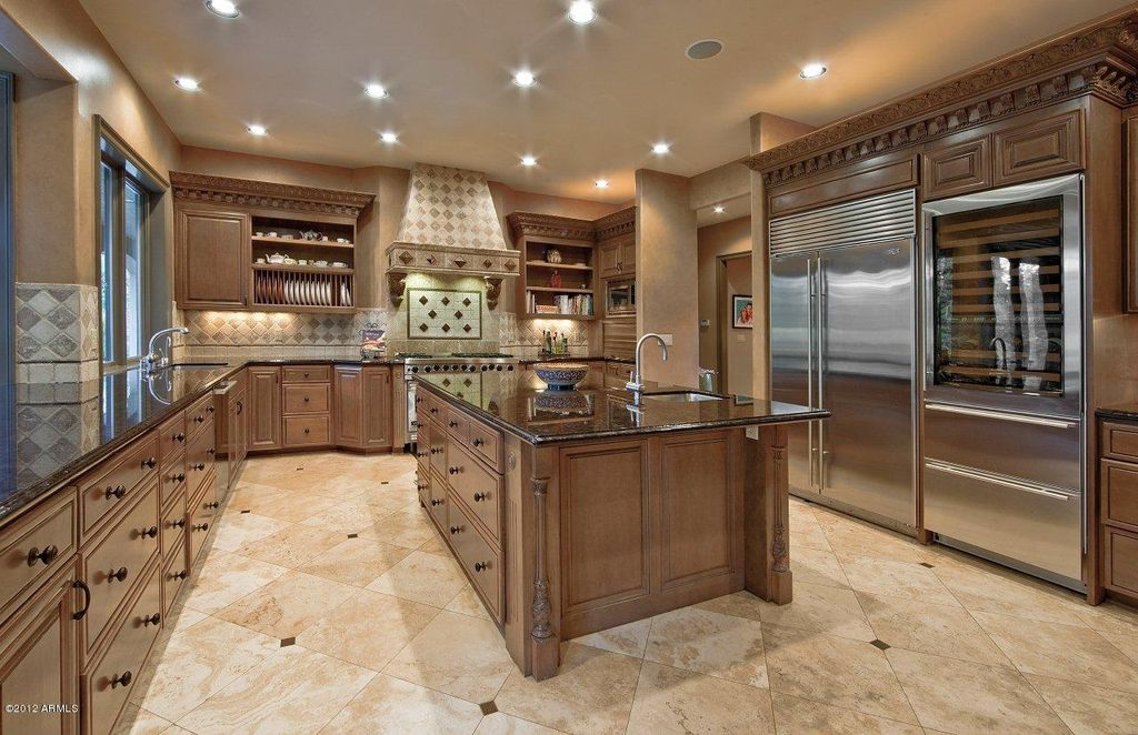 Traditional Kitchen with Custom hood, Built-in bookshelf, Casement, Framed Partial Panel, Stone Tile, full backsplash