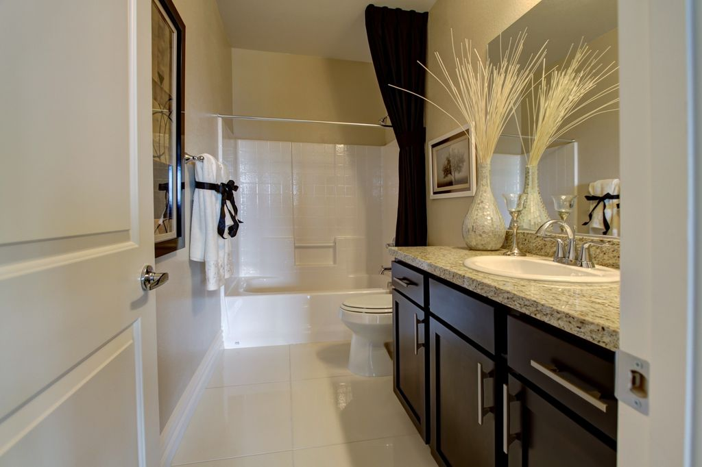 Modern Full Bathroom with drop-in sink, large ceramic tile floors, drop in bathtub, shower bath combo, Flat panel cabinets