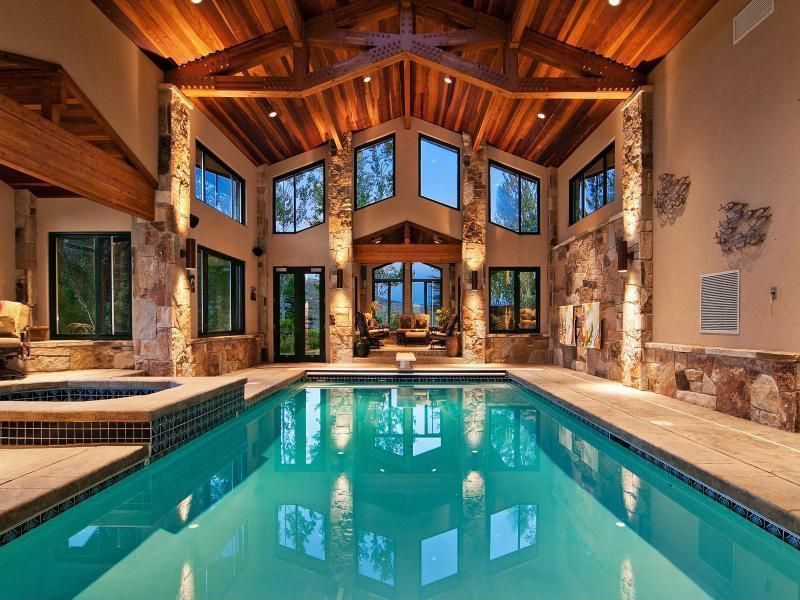 Craftsman Swimming Pool with Indoor swimming pool with hot tub, Exposed ceiling beams, Paint 1, Zillij Tile