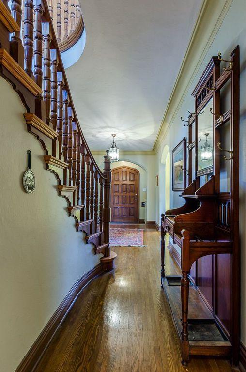 Traditional Hallway with Crown molding, Built-in bookshelf, Hardwood floors, Standard height