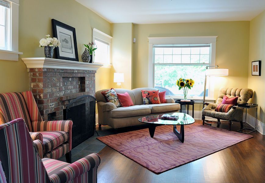 Traditional Living Room with brick fireplace, double-hung window, Casement, Standard height, Fireplace, Hardwood floors