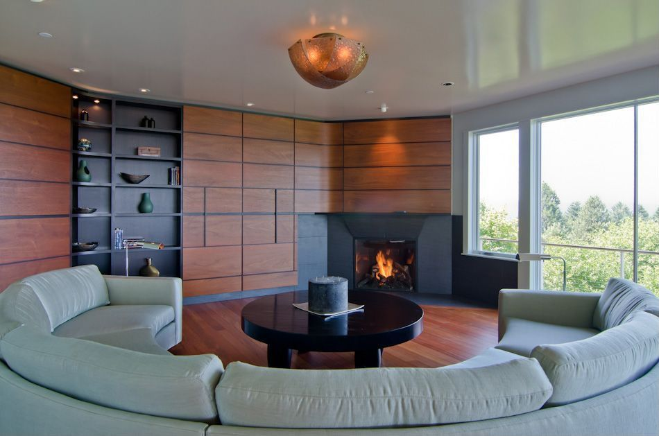 Contemporary Living Room with insert fireplace, Standard height, can lights, picture window, Hardwood floors, flush light