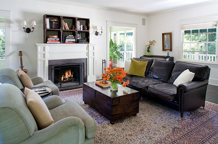 Contemporary Living Room with Casement, Wall sconce, Crown molding, Hardwood floors, Cement fireplace, Fireplace