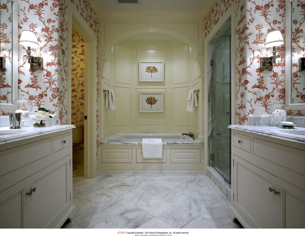 Traditional Master Bathroom with Complex marble counters, frameless showerdoor, Wall sconce, Complex Marble, drop in bathtub