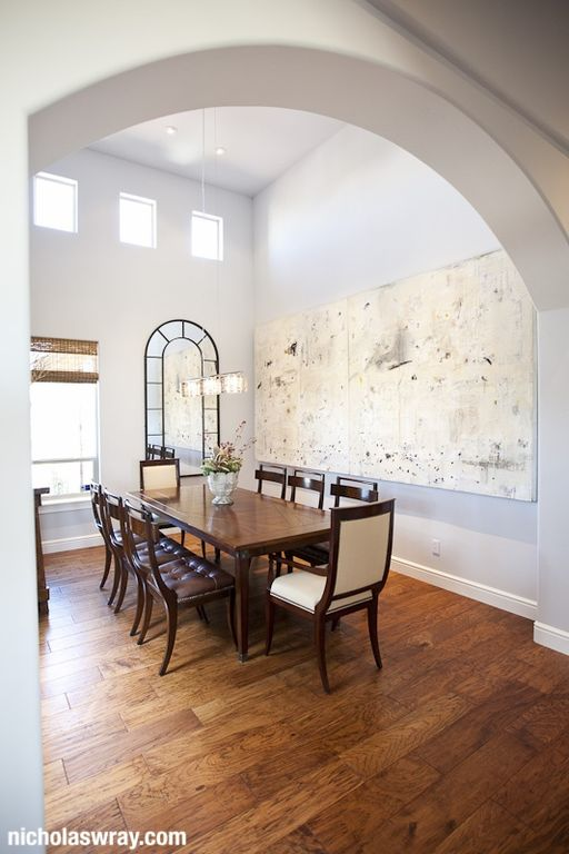 Contemporary Dining Room with Hardwood floors, Pendant light, picture window, double-hung window, High ceiling, can lights
