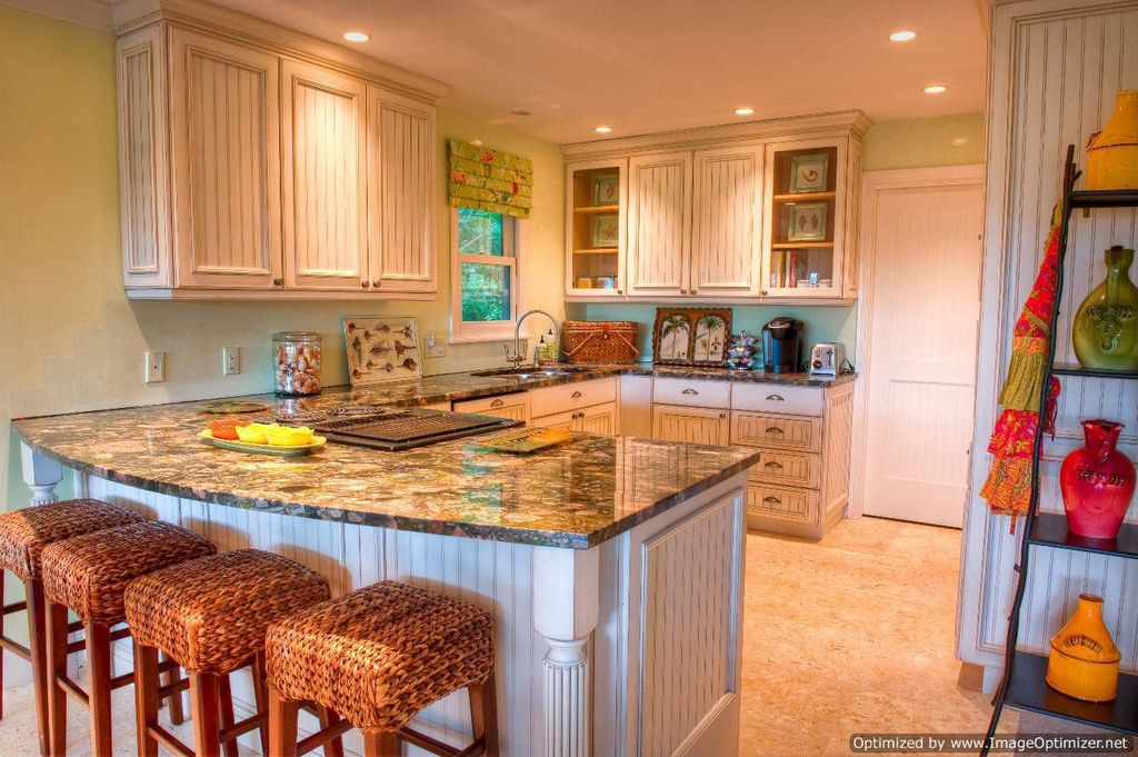 Cottage Kitchen with electric cooktop, Pottery barn seagrass backless barstool, Paint 1, Standard height, flat door, Casement