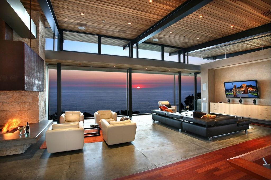 Contemporary Living Room with stone fireplace, Frasier Leather Chair, picture window, Paint, French doors, Concrete tile