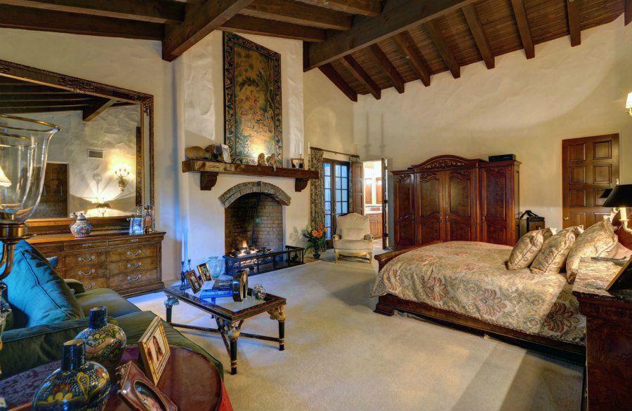Mediterranean Master Bedroom with Exposed beam, Master bathroom, Standard height
