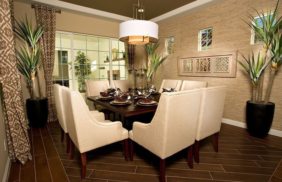 Contemporary Dining Room with Casement, Crown molding, Pendant light, Standard height, interior wallpaper, can lights