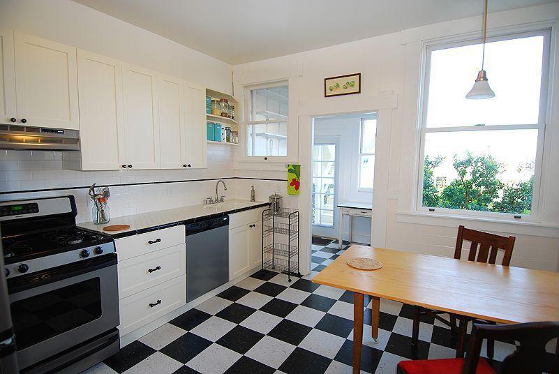 Modern Kitchen with Undermount sink, Glass panel door, Subway Tile, dishwasher, Pendant light, gas range, Breakfast nook