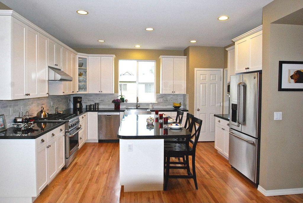 Traditional Kitchen with Glass panel, six panel door, Recessed lighting, Pottery barn - aaron barstool, Hardwood floors