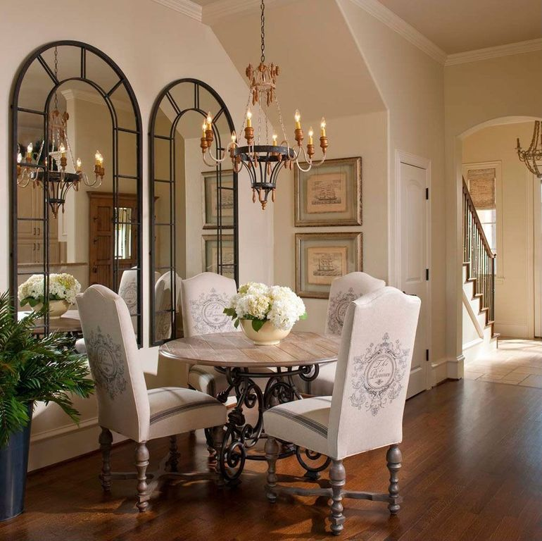 Traditional Dining Room with High ceiling, Paint 1, Crown molding, Distiller arch mirror, Chandelier, Hardwood floors