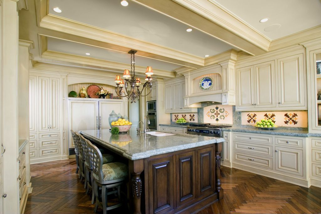 Traditional Kitchen with Crown molding, wall oven, Simple granite counters, Exposed beam, built-in microwave, gas range