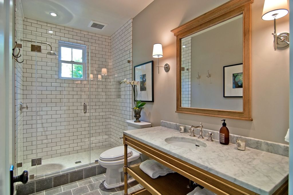 Traditional 3/4 Bathroom with Wall sconce, three quarter bath, Rain shower, stone tile floors, Console sink, Shower, Paint