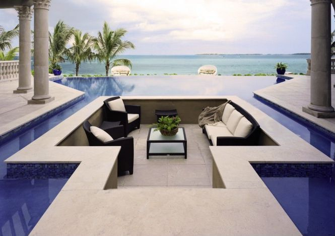 Contemporary Swimming Pool with Deck Railing, Pathway, Infinity pool, exterior tile floors, exterior concrete tile floors