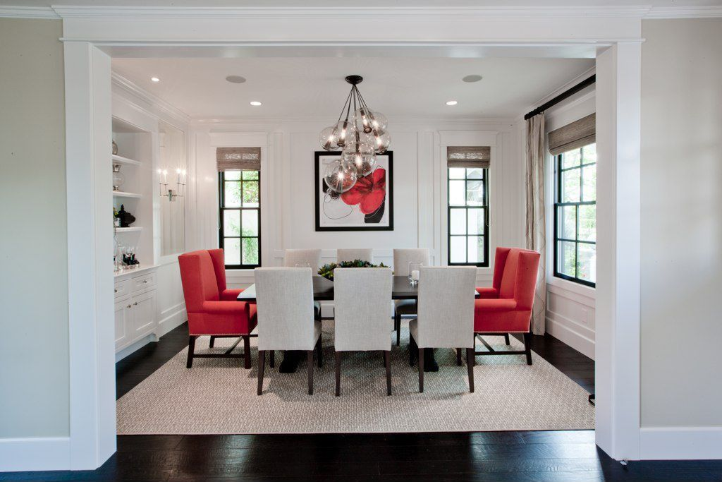 Contemporary Dining Room with Roman shades, double-hung window, Built-in bookshelf, Chandelier, Wall sconce, Crown molding