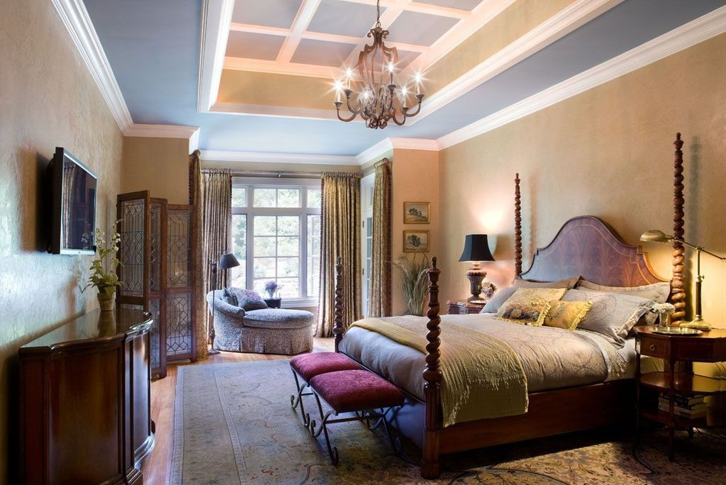 Traditional Master Bedroom with Crown molding, Box ceiling, High ceiling, Laminate floors, Chandelier, Casement