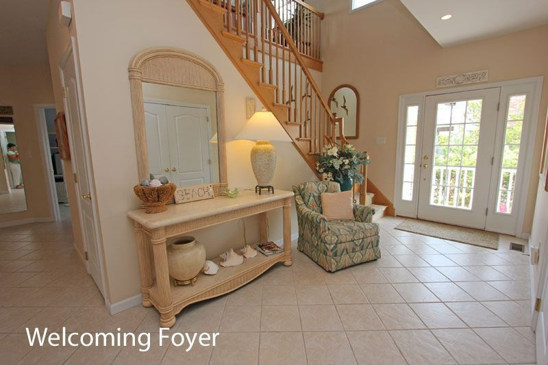 Cottage Entryway with sandstone tile floors, French doors