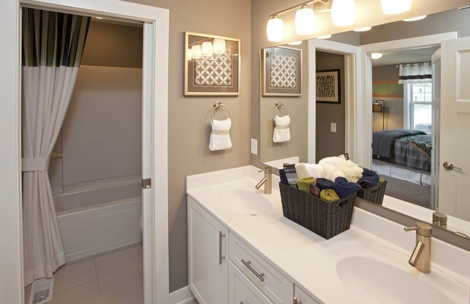 Traditional Master Bathroom with stone tile floors, Flat panel cabinets, Double sink, Undermount sink, partial backsplash