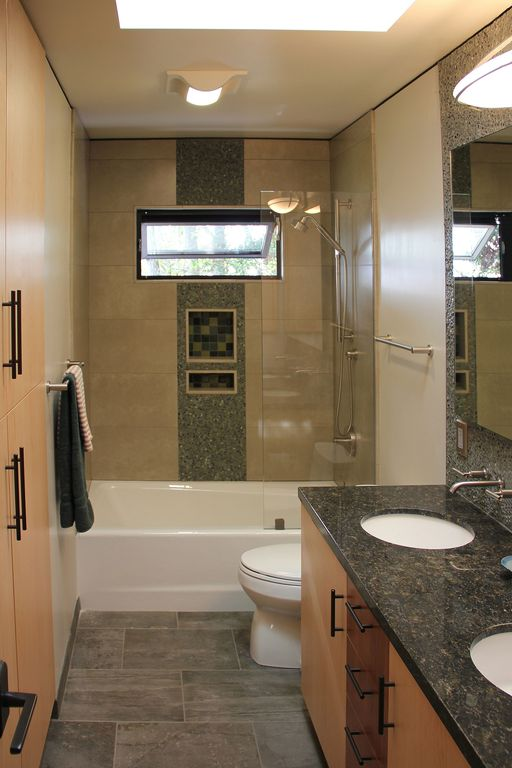 Contemporary Full Bathroom with Casement, Simple Granite, full backsplash, Standard height, Simple granite counters, Skylight