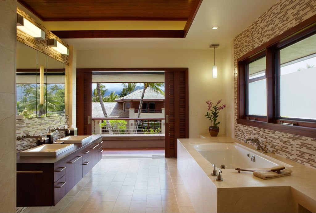 room with can lights, stone tile floors, Wood counters, Master bathroom, Ceramic Tile, full backsplash, Pendant light