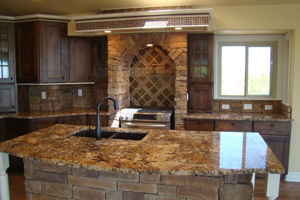 Country Kitchen with Stone kitchen island, gas range, can lights, Stone Tile, Standard height, Framed Partial Panel, Casement