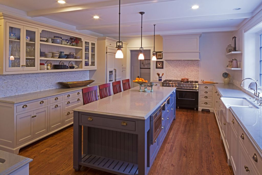 Traditional Kitchen with Framed Partial Panel, Farmhouse sink, can lights, Casement, built-in microwave, Breakfast bar