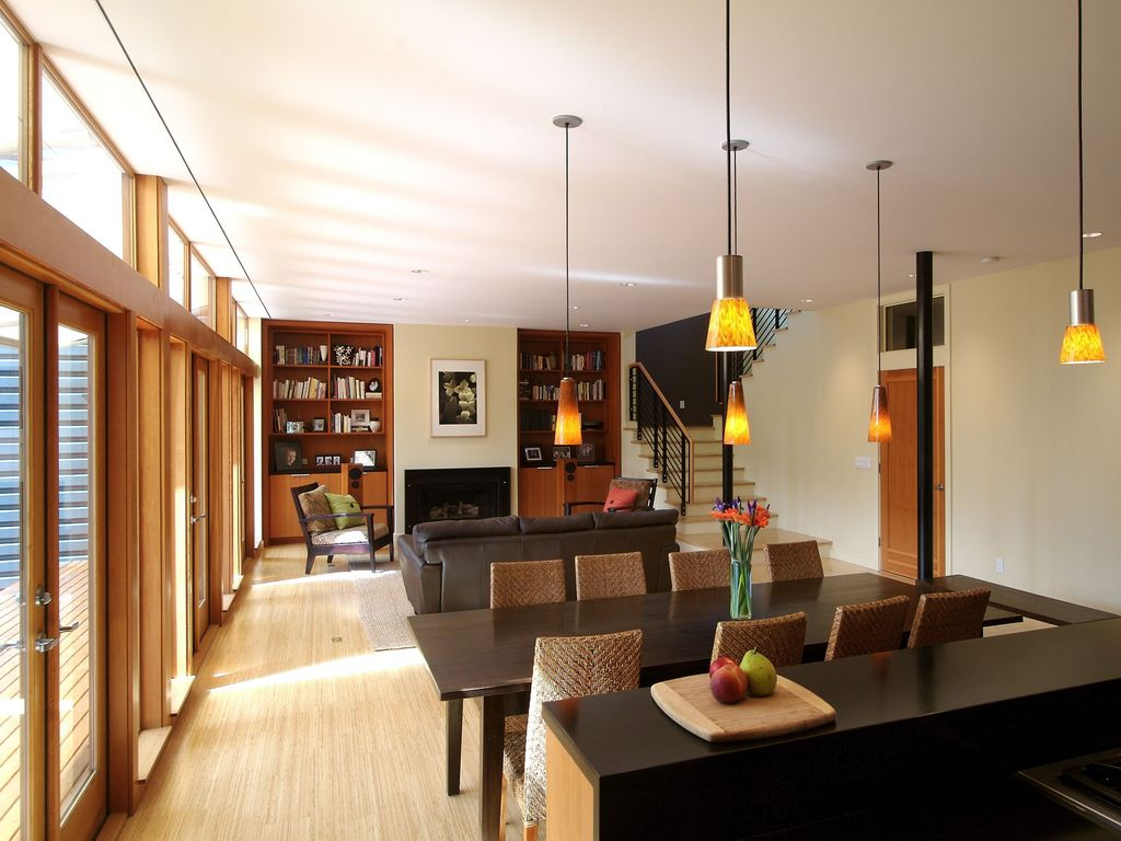 Contemporary Great Room with Laminate floors, Built-in bookshelf, Pendant light, can lights, High ceiling, Transom window