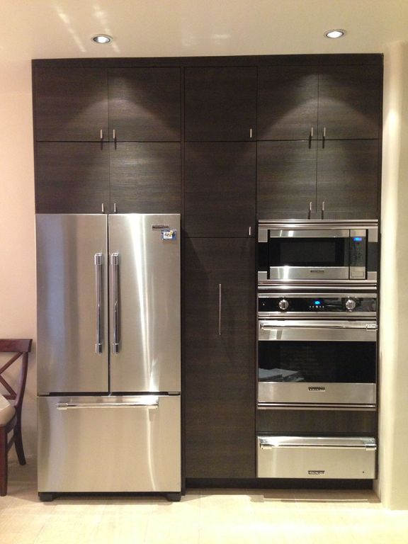 Contemporary Kitchen with can lights, European Cabinets, built-in microwave, French door bottom freezer refrigerator