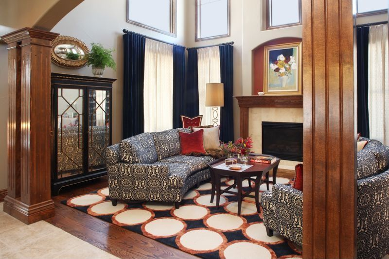 Modern Living Room with Fireplace, Laminate floors, picture window, stone fireplace, Columns, Cathedral ceiling, Skylight