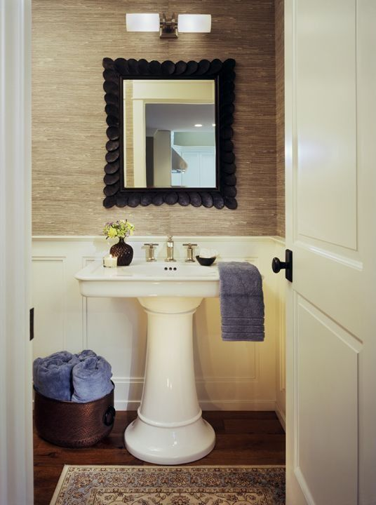 Traditional Powder Room with specialty door, interior wallpaper, Wainscotting, wall-mounted above mirror bathroom light