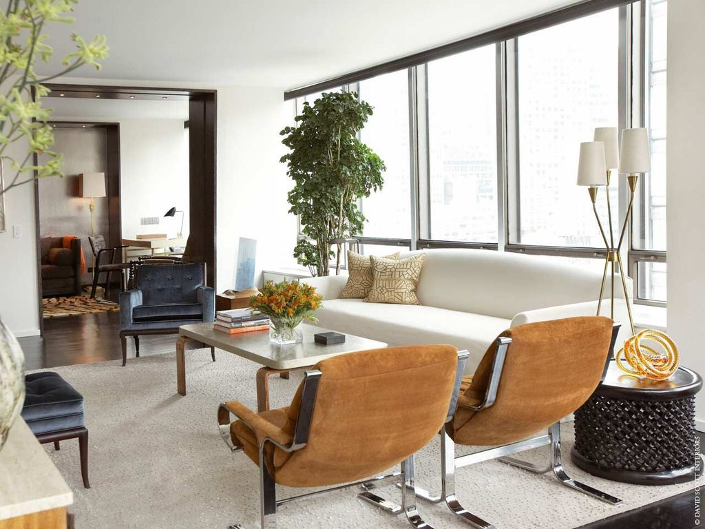 Contemporary Living Room with Laminate floors, picture window, Standard height