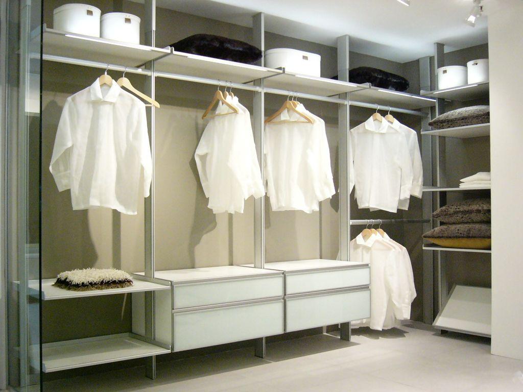 Modern Closet with Standard height, Carpet, can lights, Built-in bookshelf