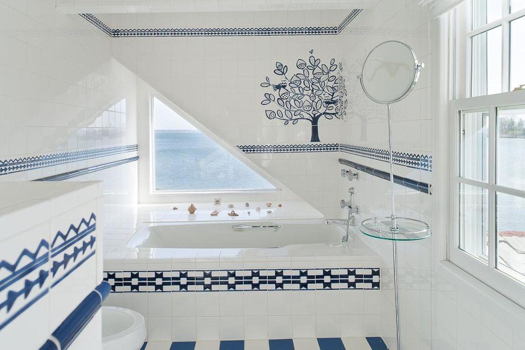 "Traditional Full Bathroom with 4"" x 4"" glossy white tile, Bathtub, Jerdon Vanity Mirror, Mural, large ceramic tile floors"