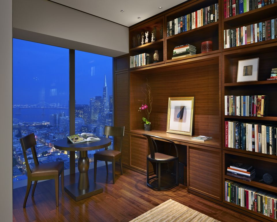 Modern Home Office with can lights, Built-in bookshelf, Laminate floors, picture window, High ceiling