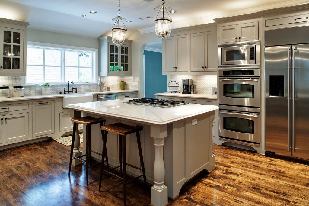 Traditional Kitchen with single dishwasher, Hardwood floors, Ceramic Tile, Kitchen island, can lights, under cabinet lights