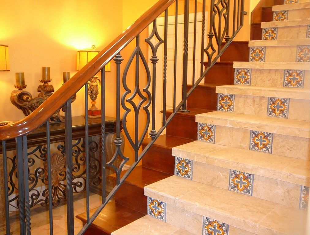 Eclectic Staircase with Hardwood floors, terracotta tile floors, curved staircase, High ceiling