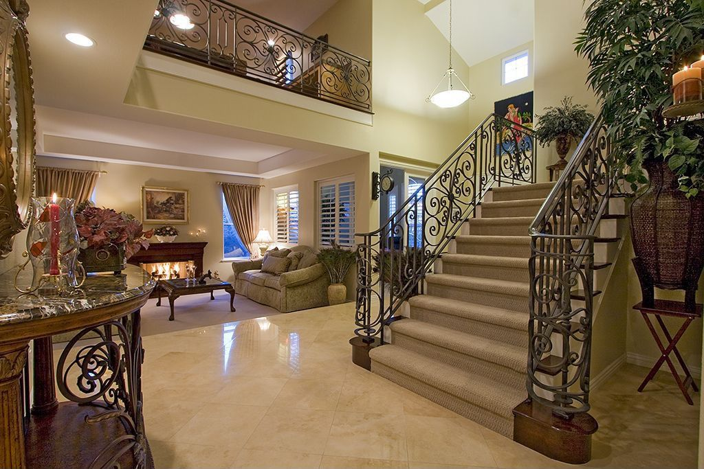 Mediterranean Staircase with Casement, Loft, Floating staircase, can lights, Pendant light, Fireplace, Cathedral ceiling