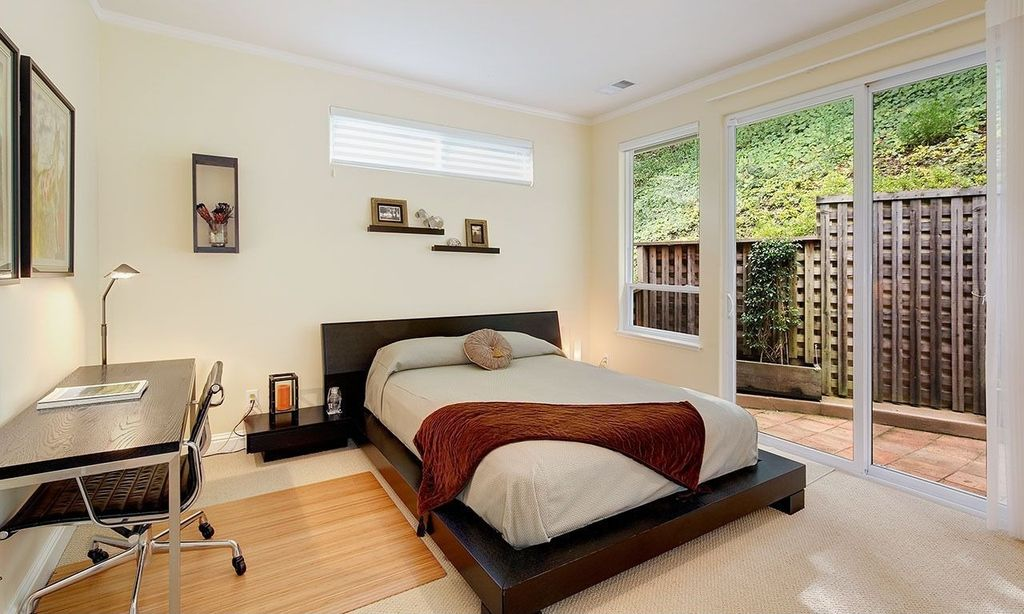 Contemporary Guest Bedroom with Standard height, double-hung window, Carpet