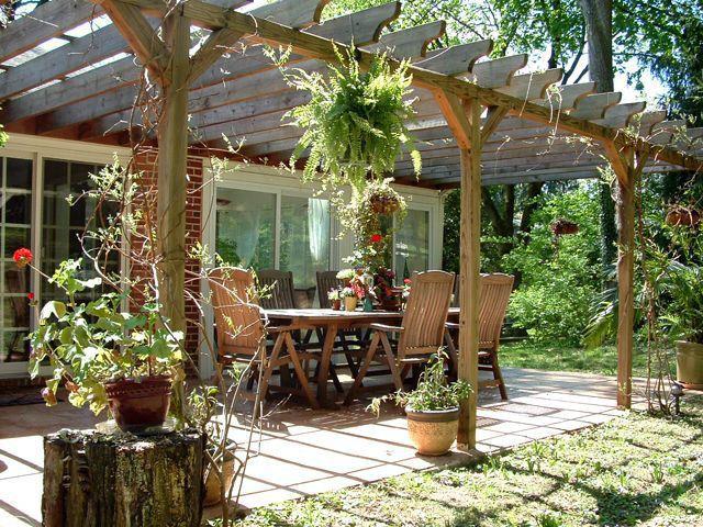 Cottage Patio with exterior tile floors, Casement, exterior concrete tile floors, Trellis, sliding glass door