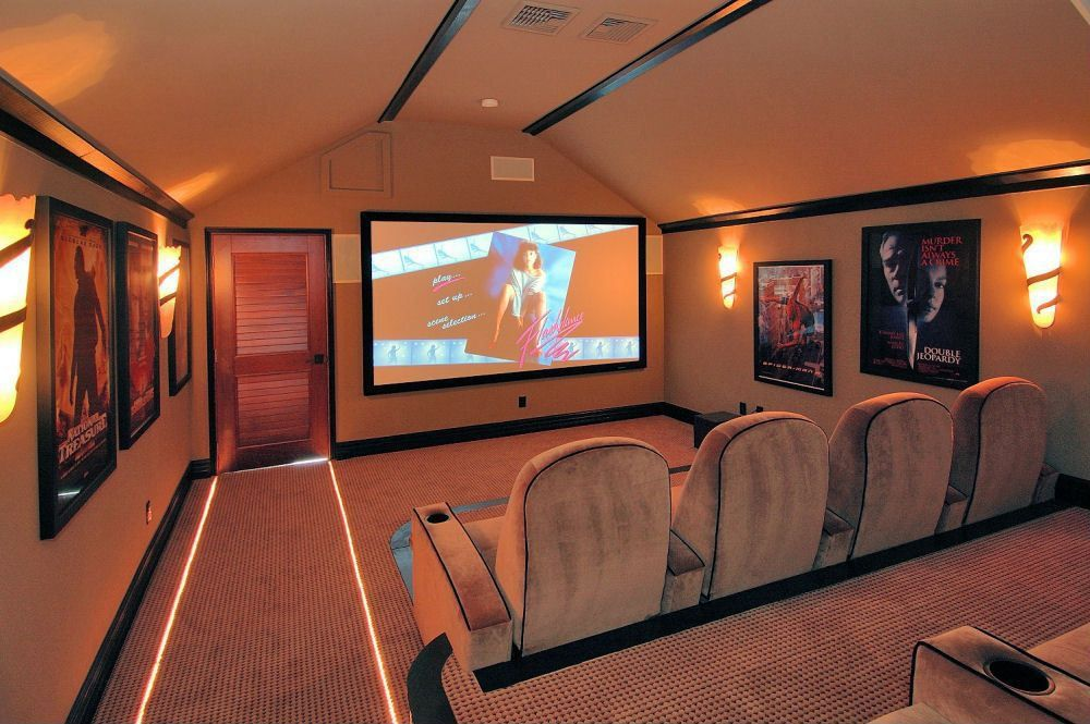 Craftsman Home Theater with Crown molding, Louvered door, Carpet, interior wallpaper