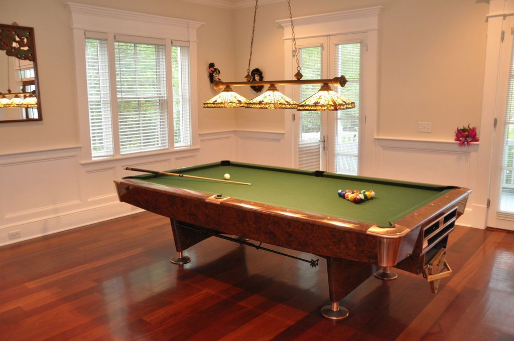 Traditional Game Room with Crown molding, French doors, Casement, Laminate floors, Standard height, Pendant light