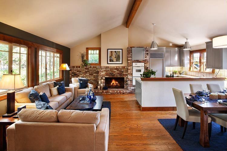 Traditional Great Room with Fireplace, Pendant light, Pottery barn - grayson side chair, stone fireplace, Exposed beam